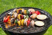 foto of braai  - Delicious grilled vegetarian skewers on burning coals - JPG