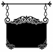 image of scrollwork  - Wrought iron ornate vintage sign bracket in black and white with intricate scrollwork hanging from chain links from a rod for the front of an old town shop available in several different formats in gallery - JPG