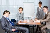 stock photo of business meetings  - Photo of businesspeople looking sternly at their sleeping colleague at presentation - JPG
