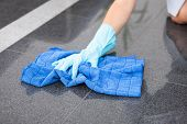 stock photo of maids  - Young Happy Maid Cleaning The Floor With Cloth - JPG