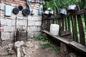 image of junk-yard  - Pots and junk in the nook of the yard of one Romanian village - JPG