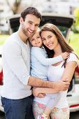 picture of family bonding  - Happy family with car on background  - JPG