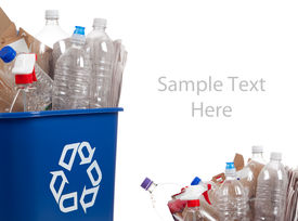 stock photo of plastic bottle  - A blue recycle can with plastic bottles and paper on a white background with copy space - JPG