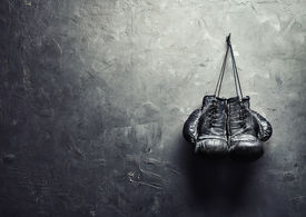 stock photo of text-box  - old boxing gloves hang on nail on texture wall with copy space for text - JPG