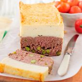 stock photo of meatloaf  - Beef Meatloaf with Green Peas Topped with Cheesy Mashed Potato square - JPG