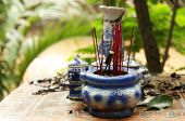 image of altar  - Buddhist altar with joss sticks in a tropical village