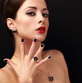 stock photo of fingernail  - Beautiful fashion model with jewelry accessories and black fingernail looking sexy - JPG