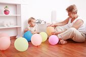 picture of nana  - Cute little boy playing with his grandmother - JPG