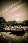 stock photo of reining  - Yachts and boats near moorage at sunset in Reine village - JPG