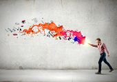 foto of supernatural  - Young man in casual throwing colorful paint splashes - JPG