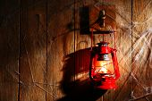 stock photo of hook  - Lantern hanging on hook on wooden wall - JPG
