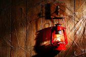 stock photo of hook  - Lantern hanging on hook on wooden wall - JPG