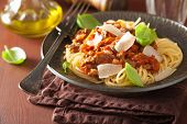 image of pasta  - italian pasta spaghetti bolognese with basil on rustic table - JPG