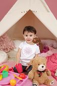 picture of teepee tent  - Toddler child kid engaged in pretend play with food stuffed toys and teepee tent - JPG