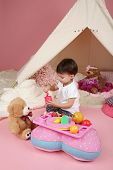 pic of teepee tent  - Toddler child kid engaged in pretend play with food stuffed toys and teepee tent - JPG