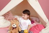 foto of teepee tent  - Toddler child kid engaged in pretend play with princess crown and teepee tent - JPG