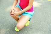 picture of sports injury  - Sports injuries of girl outdoors  - JPG