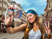 picture of flirty  - Happy traveler woman is taking selfie - JPG