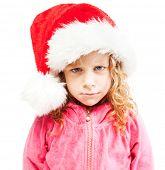 stock photo of sad christmas  - Sad girl in santa hat - JPG