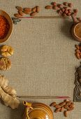 stock photo of sackcloth  - Nuts, incense, ginger and figs with recipe template on a sackcloth