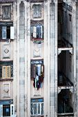 image of street-rod  - drying clothes in the windows of the old house - JPG