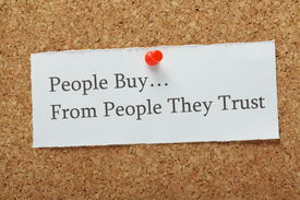stock photo of loyalty  - The phrase People Buy From People They Trust on a cork notice board as a concept for businesses to build customer trust and loyalty to their product or service - JPG