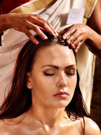 foto of panchakarma  - Young woman having head ayurveda spa treatment - JPG