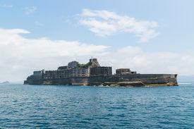 "picture of battleship  - Hashima Island, commonly called Gunkanjima (meaning ""Battleship Island""), is former coal mining island. It"