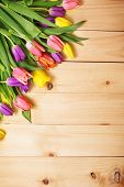 image of floral bouquet  - Spring Flowers bunch at wood floor texture - JPG