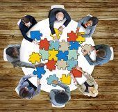 stock photo of jigsaw  - Jigsaw Puzzle Brainstorming Business Discussion Thinking Strategy Concept - JPG