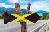 foto of jamaican flag  - Jamaica Flag sign with road background  - JPG