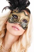 picture of mystery  - Beautiful young woman in a mysterious gold Venetian mask - JPG