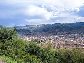 stock photo of andes  - view to old incan city of Cuzco with mountains of andes in background - JPG