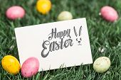 stock photo of easter candy  - Happy easter against blank greeting card with easter eggs - JPG
