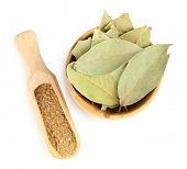 stock photo of bay leaf  - Bay leaves in wooden bowl - JPG