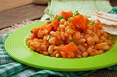 stock photo of stew  - Stewed white beans and sliced pumpkin in tomato sauce - JPG