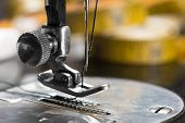 stock photo of sewing  - Close up of vintage sewing machine needle - JPG