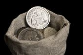 pic of sack dollar  - Sack bag with old silver coins isolated on black - JPG