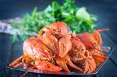 stock photo of creole  - boiled cancer on metal tray and on a table - JPG