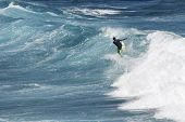 picture of watersports  - Extreme surfer riding giant ocean wave in Hawaii - JPG