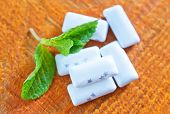 stock photo of mints  - mint gum with fresh mint on the wooden table - JPG