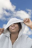 stock photo of cornrow  - Afro beauty playing with her hooded sweatshirt - JPG