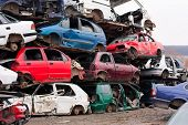 foto of piles  - Piled up destroyed cars in the junkyard - JPG