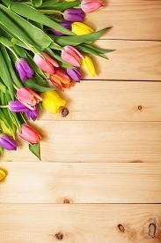 image of invitation  - Spring Flowers bunch at wood floor texture - JPG