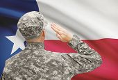 foto of texans  - Soldier saluting to USA state flag conceptual series  - JPG