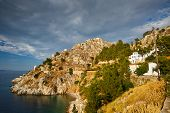 stock photo of hydra  - Small beach and a seaside walk connecting different parts of  Hydra town - JPG