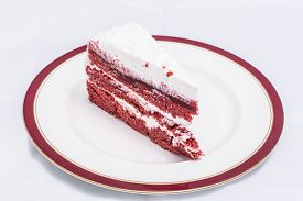 picture of red velvet cake  - Red velvet cake is very dramatic looking with its bright red color sharply contrasted by a white cream - JPG
