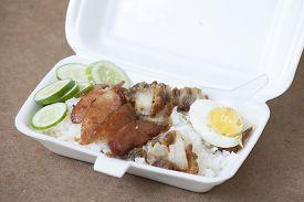 pic of crispy rice  - BBQ Pork fried Ferment pork and Crispy Pork with steam rice in foam box - JPG