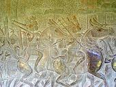 stock photo of mahabharata  - Khmer warriors sculpted on a stone wall  - JPG