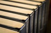 stock photo of leather-bound  - A row of leather bound books - JPG